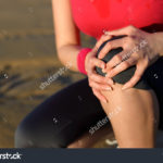 stock-photo-runner-sport-knee-injury-woman-in-pain-while-running-in-beach-156456452